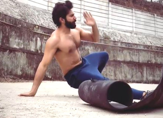 Varun Dhawan works out in the open; Ileana D'Cruz has her focus on his yoga mat